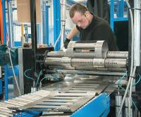 A Centek S2 casing centralizer and centralizer cylinders being formed from laser-cut sheet steel