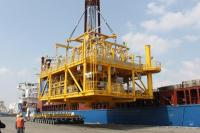 CSP (Conductor Supported Platform) topsides being loaded into the Industrial Force vessel for transportation to Cotonou