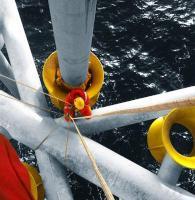 Claxton spider deck centralizer being installed