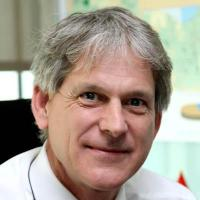 Dr. Patrick Allman-Ward; CEO of Dana Gas