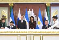 Miguel Galuccio; Vladimir Putin; Cristina Fernandez de Kirchner and Alexey Miller.