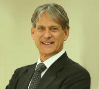 Dr Patrick Allman-Ward- CEO of Dana Gas