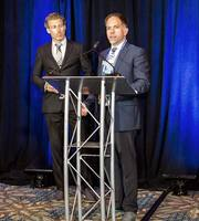 Fugro - Todd Mitchell receives the award from NOAA's Craig McLean